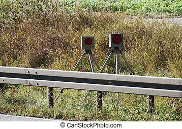 Radar trap hidden behind a safety fence...