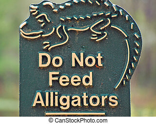 Do not feed alligators sign