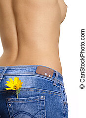 Nude girl with yellow flower - Nude girl with blue jeans and...
