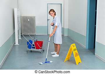 Janitor With Wet Caution Sign And Cleaning Equipments -...