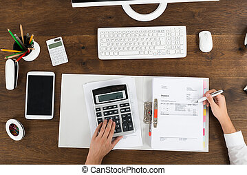 Businessperson Calculating Tax - High Angle View Of...