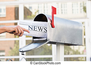 Person Hands Opening Mailbox To Remove Newspaper - Close-up...
