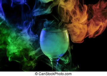 Blue-green-orange smoke in the glass. Halloween. - Abstract...