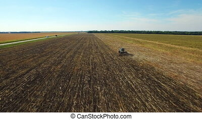 Aerial: Tractor plowing the soil