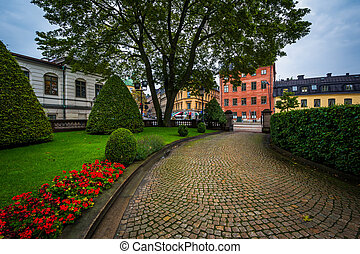 Cobblestone walkway and garden in front of Riddarhuset, the...