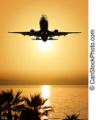 beautiful sea view and plane on sunset background