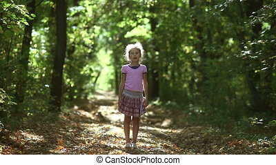 teen girl in the forest raises his arms to the sun meditation oneness with nature autumn sunlight road