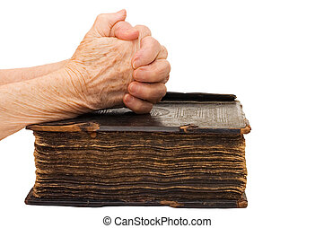 Old female hands on the bible