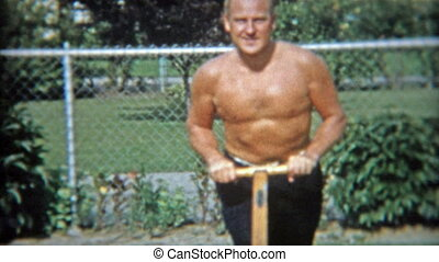 1953: Shirtless man showing off - Original vintage 8mm film...