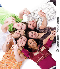 Carefree teenagers - Group of carefree teenagers lie on the...