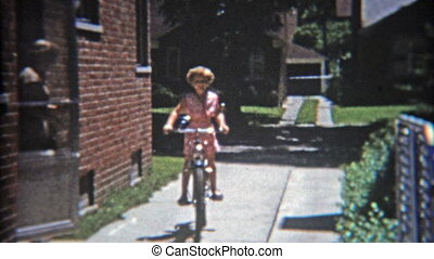 1953: Girl riding bike aggressively - Original vintage 8mm...