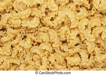 dry uncooked creste di galli pasta texture background -...