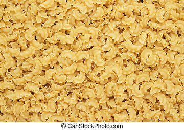 dry uncooked creste di galli pasta texture background - dry...
