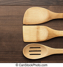 wooden spoons on the table - different wooden kitchen tools...