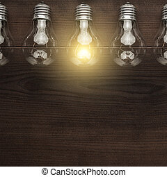 glowing bulb uniqueness concept with copy space on brown...