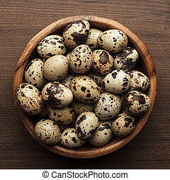 quail eggs on the brown wooden table - some quail eggs on...