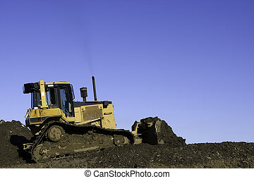 Bulldozer Clearing Land - Bulldozer in operation moving dirt...