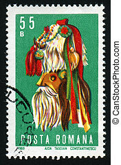 postmark - ROMANIA - CIRCA 1969: National Romanian mask,...