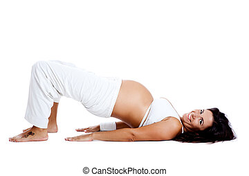 Pregnancy exercises - Pregnant woman making fitness...