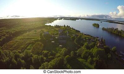 flying over Shuezero lake in Karelia at sunset