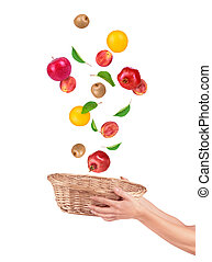 Fruit alling from basket isolated on a white