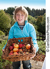 Young boy with a basket of fruit - Young boy posing with a...