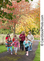 Parents walking outdoors with children - Parents walking...