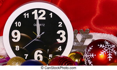 Clock and christmas toys in a red bag, zoom in - Clock and...