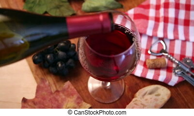 Wine being poured into wine glass.