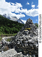 Tibet snow mountain with Mani Dui in China