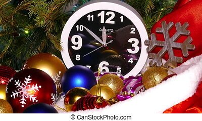 Clock and christmas toys in a red bag - Clock and christmas...