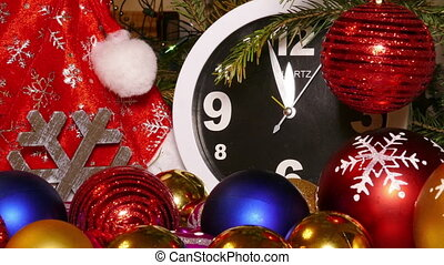 Clock and christmas balls and toys in a red bag, timelapse,...