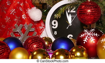 Clock and christmas toys in a red bag, timelapse - Clock and...