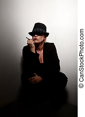 Mysterious Woman - Mysterious woman crouched in corner with...