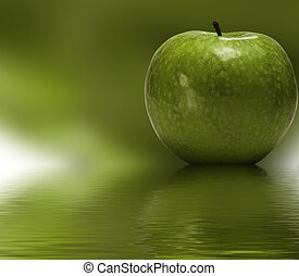 Green apple reflected in to the water