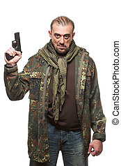 Male terrorist in a military jacket with a gun in his hand....