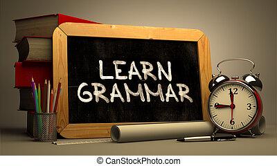 Handwritten Learn Grammar on a Chalkboard. - Handwritten...