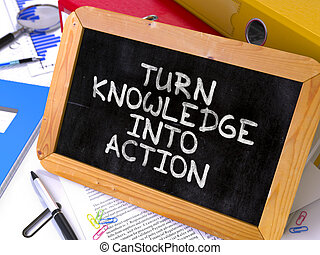 Turn Knowledge into Action Concept Hand Drawn on Chalkboard....