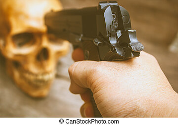 Gun and skull, still life. - Still life human skull and gun...