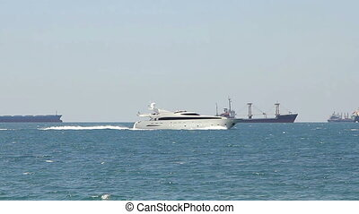 Luxury white speed yatch in open waters at sunny day