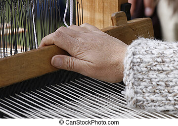 Spinning jenny - Close-up view of handloom weaver hands