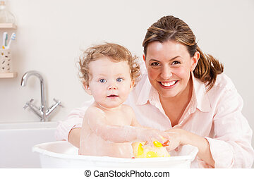 Baby Bath Time - Baby girl looking at the camera whilst...