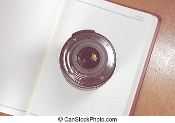 Camera photo lens on notebook ,concept photography - Vintage...