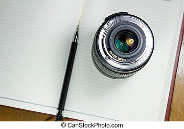 Camera photo lens on notebook ,concept photography