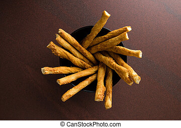 pastry sticks with cheese in a bowl