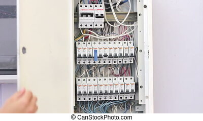 Switching Electric Breaker Box. - 380 Volts. Man hand turns...