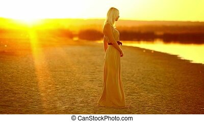 Young seductive girl woman dancing at sunset smiling sexy...