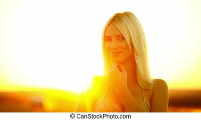 Young seductive woman girl portrait smiling at sunset sexy...