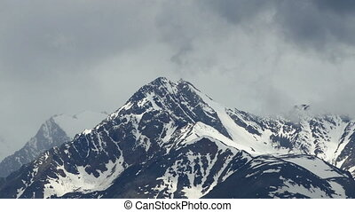 snow-capped mountain peaks and clouds, timelapse -...
