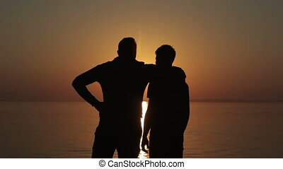 Happy gay couple  watching sunset on the beach Full HD